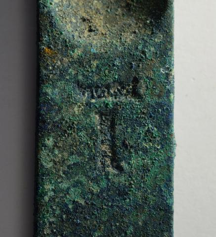 Maker's Mark on Copper Alloy Strigil, Casa Imperiale, Pompeii (Italy).